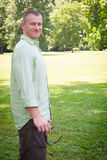 Living Green: Confident Man Enjoying the Outdoors Stock Photography
