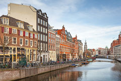 Living houses along the canal embankment in Amsterdam Stock Images