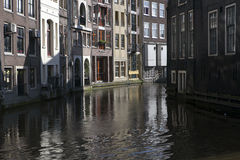 Living houses along the canal embankment in spring day. Royalty Free Stock Image