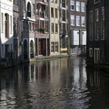 Living houses along the canal embankment in spring day. Stock Image