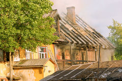 Living houses fighting a fire Stock Photos