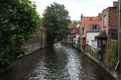Living houses on the Historic Canals of Bruges stock photos