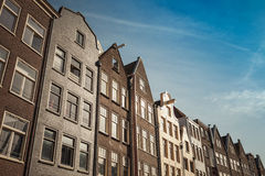 Living houses stand along Canal in Amsterdam Stock Photo