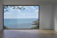 Living Indoor Empty loft Concrete on Sea view. /Modern living Room luxury on The beach Royalty Free Stock Images