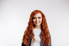 Living life to fullest. Portrait of attractive carefree european female with ginger hair, laughing out loud over white background royalty free stock image