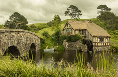 Living with nature - old fashioned beautiful farm house. Old fashioned classic farm house close to waterways with bridge, living with nature, peaceful Royalty Free Stock Photography