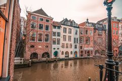 Living near the canal. Beautiful old town in Amsterdam, The Netherlands. stock photos