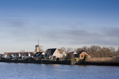 Living near the river. The skyline, with windmill, of Krimpen aan den IJssel in the Netherlands Stock Images