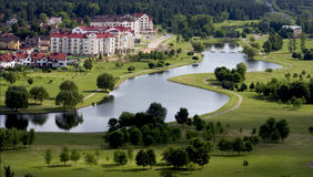 Living Quarters in Minsk Belarus. Horizontal image of beautiful, Switzerland-like living quarters in Minsk, Belarus with small river winding, green grass and Stock Photo