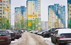 Living in residential area of city: houses, cars, people Stock Image
