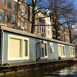 Living on a river in Amsterdam Royalty Free Stock Photos