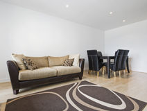Living room. Smart contemporary living room with dining table stock photography