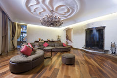 Living room. Modern living room with magnificent ceiling and fireplace Stock Photos