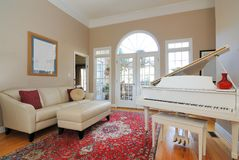 Living Room. Contemporary Living Room Interior with sofa, couch, piano, and window view of the patio deck Royalty Free Stock Photo