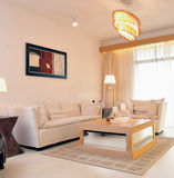 Living Room. A view of a modern living room in a beige and wooded theme. The room is furnished Stock Photos