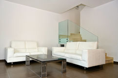 Living room. Modern white living room with up stairs Royalty Free Stock Image