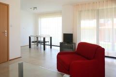 Living room. Red sofa stock photo
