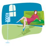 Living room. Young woman relaxing in her living room Royalty Free Stock Photography