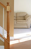 Living Room. View of stairs and couch in next room Royalty Free Stock Image