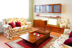 Living room. Interior of living room with floral sofa stock photo