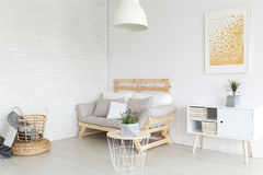 Living room in apartment. Simple lagom living room in white minimalist apartment stock image