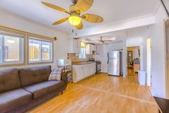 Living room with bamboo flooring and paneled ceiling fan royalty free stock photography