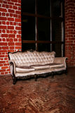 Living room with beige sofa on the  red brick wall Stock Photos