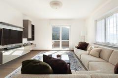 Living room with big sofas Stock Photography