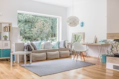 Living room and big window. Cozy bright living room and big window royalty free stock photo