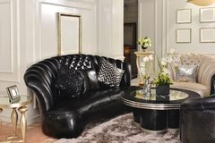 Living room with black leather sofa royalty free stock image