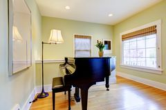 Living room with black piano and large window. Royalty Free Stock Photos