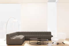Living room with black sofas and armchair, toned Stock Image