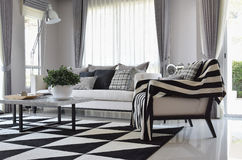 Living room with black and white checked pattern pillows Royalty Free Stock Images