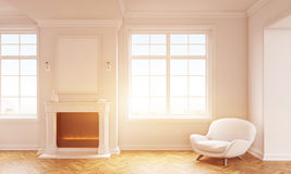 Living room with blank frame. Front view of classic living room interior with wooden floor, white armchair, windows with city view and a blank picture frame Stock Photo