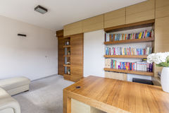 Living room with bookcase Stock Photography