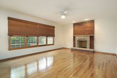 Living room with brick fireplace Stock Photo