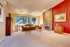 Living room with brick fireplace and carpet. Royalty Free Stock Image