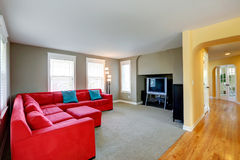 Living room with bright red couch and TV Stock Photo