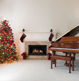 Living room with burning fireplace decorated for Christmas seaso Royalty Free Stock Photography