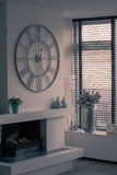 Living room. A living room with clock ans plants Royalty Free Stock Photos