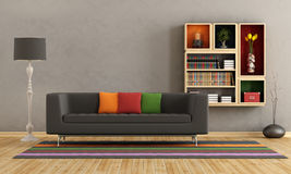 Living room with colorful sofa and bookcase Royalty Free Stock Photography