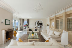 Living room, confortable white divans Stock Images