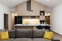 Contemporary house - living-room connected with kitchen stock photos