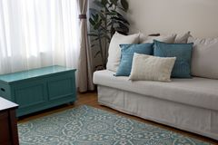 Teal & Cream Color Themed Living room royalty free stock photo