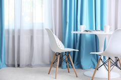 Living room with curtains. Living room with modern curtains royalty free stock photo