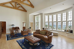 Living room with curved windows Stock Photo