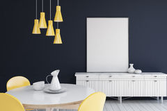 Living room with dark blue walls, poster. Living room interior with dark blue walls, a cabinet with a vertical poster standing on it and a round table. 3d Stock Photo