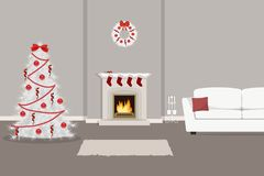 Living room, decorated with Christmas decoration. The room has a fireplace, a white sofa with a pillow, a white Christmas tree with red decorations and other Royalty Free Stock Image