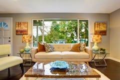 Living room with deep brown hardwood floor and modern furniture Stock Photos
