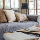 Living room design with bamboo blind Stock Image
